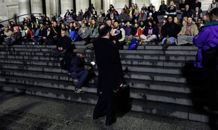 Supporters of the Occupy London Stock Exchange protest in a mass meditation at St Paul's