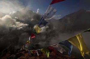 24 Hours: Tengboche, Nepal: Tibetan Buddhist prayer flags flutter in the Himalayas