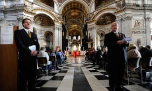 Ushers stand as the Rt Rev Graeme Knowles conducts the first service after St Paul's reopens.
