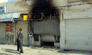 The local office of the moderate Islamist party Ennahda, which was set on fire by protestors