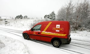 A Royal Mail van struggles through the snow in central Scotland