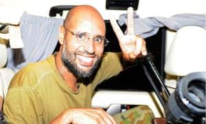Saif al-Islam gestures as he talks to reporters in Tripoli on 23 August, 2011.