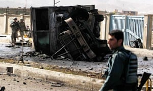 Foreign and Afghan forces arrive at the site of the suicide attack in Kabul