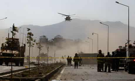 A Nato helicopter flies above the site of the bomb blast in Kabul.