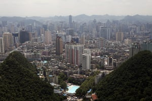 Guiyang urbanisation: A view of the city of Guiyang from the top of QianLing Mountain