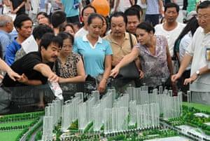 Guiyang urbanisation: Consumers look at models during a housing fair in Guiyang