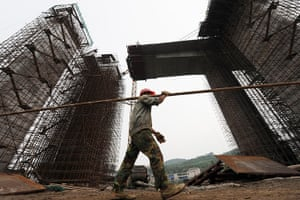 Guiyang urbanisation: A worker at the construction site of a new bridge project in Guiyang