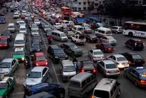 Guiyang urbanisation: Vehicles drive slowly in a traffic jam in Guiyang, Guizhou