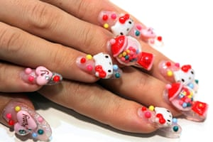 Hello Kitty: A nail artist shows her 'Hello Kitty' nails during the Tokyo Nail Expo 2009