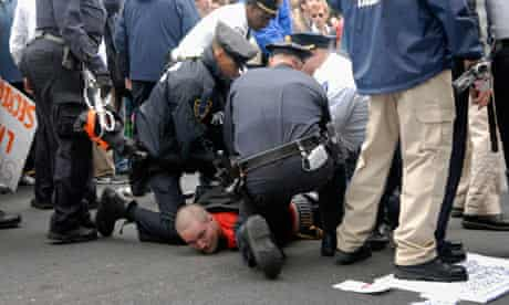 Police arrest a protester during Saturday's Occupy Wall Street march
