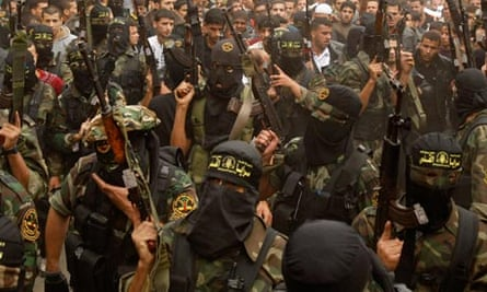 Islamic Jihad militants at the funeral of one of their comrades in the Gaza Strip