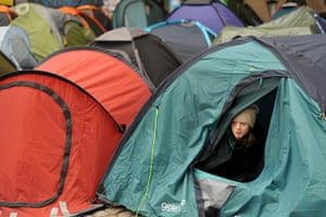 Occupy London protests: A protester from the Occupy London protests looks from his tent