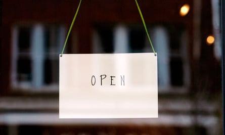 'Open' sign on small business door