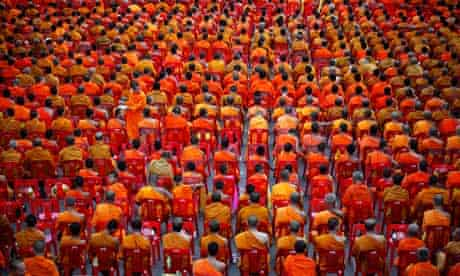Thousands of Buddhist monks attend an alms offering ceremony in Bangkok