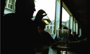 Man drinks at bar