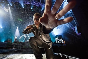 UK Festivals Exhibition: Bono of U2 takes David Levene's camera at Glastonbury
