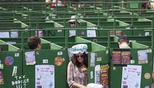 UK Festivals Exhibition: A woman exits the toilet at Glastonbury 2011