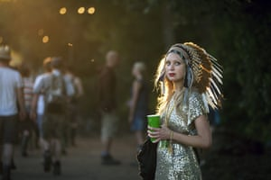 UK Festivals Exhibition: A woman in Native American headdress at Glastonbury 2011
