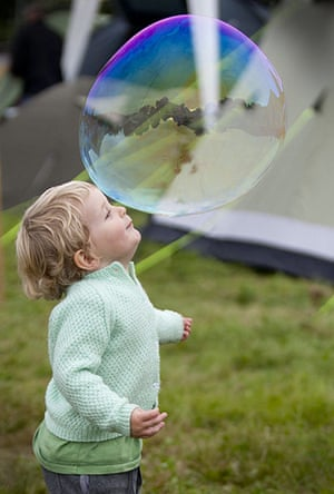 UK Festivals Exhibition: Rudy popping bubbles at the Green Man Festival, 2011