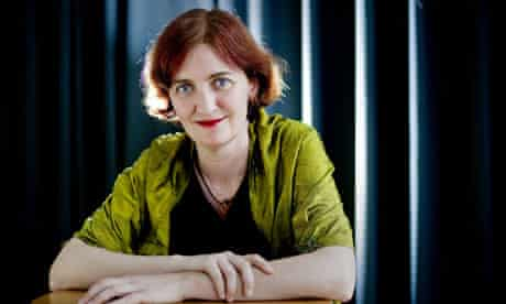 Emma Donoghue sitting at a table