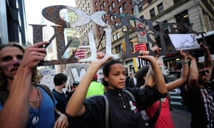 Occupy Wall Street demonstrators march to Foyle Square