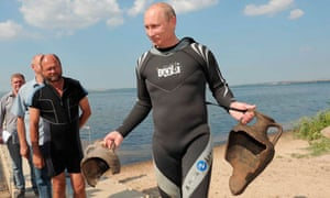 Vladimir Putin carries urns recovered from floor of the Black Sea