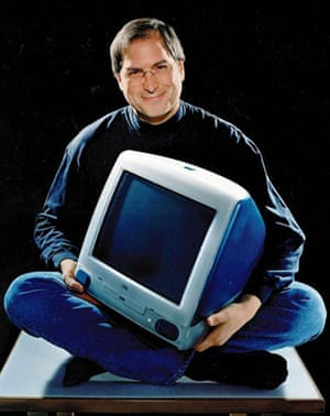 steve jobs dies: 1998: Jobs holds the iMac at the all-in-one computer's launch in California