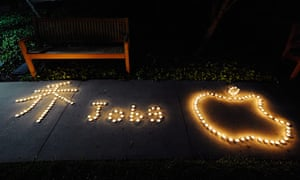 Steve Jobs Apple shrines: Cupertino, California: Students used candles to create the Apple logo
