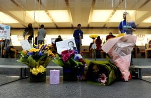 Steve Jobs Apple shrines: Sydney, Australia: Flowers left outside the Apple store on George Street