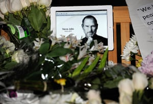 Steve Jobs Apple shrines: Cupertino, California:  Flowers and an iPad showing a picture of Steve Jobs