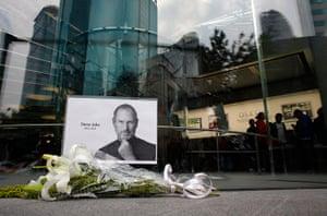 Steve Jobs Apple shrines: Shanghai, China: Flowers in memory of Jobs are seen outside an Apple Store