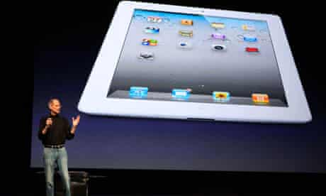 Apple CEO Steve Jobs introducing the iPad 2 on stage during an Apple event in San Francisco
