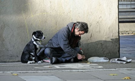 Homeless man with his dog in London.