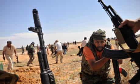 Libyan forces under fire from Gaddafi loyalists in Sirte