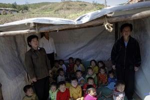 Famine in North Korea: North Korean children whose kindergarten was destroyed by recent floods