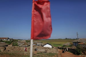 Famine in North Korea: North Korean children are seen under a red flag