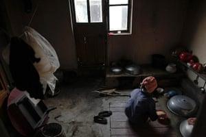 Famine in North Korea: A North Korean woman prepares a meal