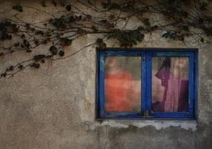 Famine in North Korea: North Korean girls look through a window