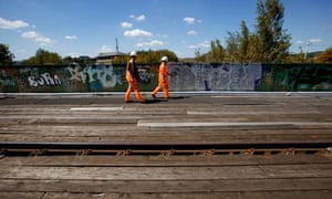 Network Rail workers in Sheffield working to replace copper wiring stolen from trackside.