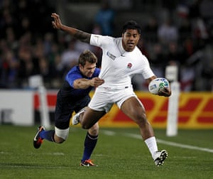 England v France: Manu Tuilagi goes on a surging run but is stopped by Vincent Clerc