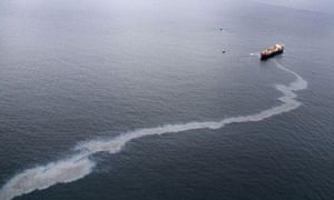 An oil slick streams from the Rena, a 47,000 tonne ship grounded in New Zealand's Bay of Plenty