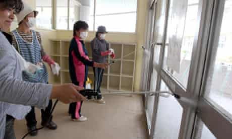 Teachers and parents carry out radioactive decontamination work at a school in Fukushima prefecture