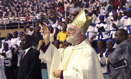 The archbishop of Canterbury, Rowan Williams, blesses the congregation at Harare's national stadium