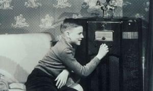 boy listening to wireless set