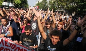 Greeks protest against their government's latest round of austerity measures in Athens