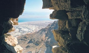 View of the Dead Sea through a hole in Masada's wall