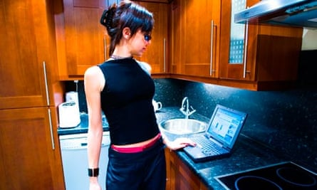 A woman using her laptop computer at home