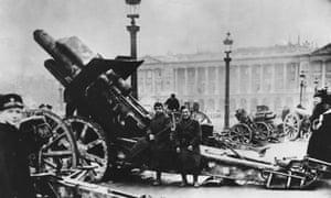 Soldiers sitting on a captured Big Bertha siege gun