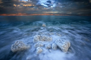 Seven wonders of nature: Boulders spiky with salt crystals edge the Dead Sea