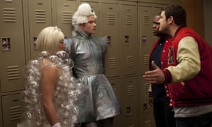 Out and proud Kurt (centre) is confonted by in-the-closet jock bully Karofsky (right) in Glee.